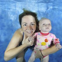 mum and baby underwater
